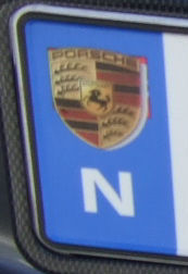 Norway close-up of blue band with a Porche logo.jpg (17 kB)